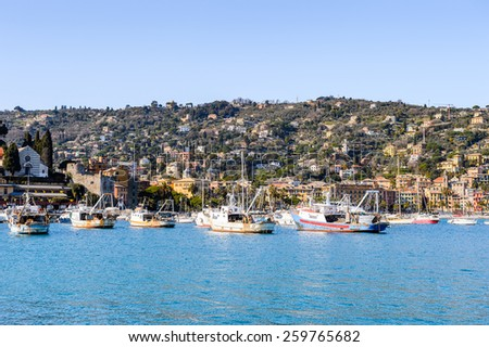 SANTA MARGHERITA LIGURE, ITALY - MAR 8, 2015: Boats near the port of Santa Margherita Ligure, which is popular touristic destination in summer