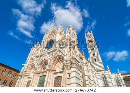 Santa Maria Assunta Cathedral in Siena, Italy. Made between 1215 and 1263, it is a major tourism attraction in Siena. - stock photo