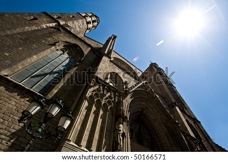 "Santa Maria del Mar is a gothic church that was built somewhere between 1300 and 1350. It is located in the ""Born"" (or ""Borne"") quarter. Here we can see one of its entrances. - stock photo"