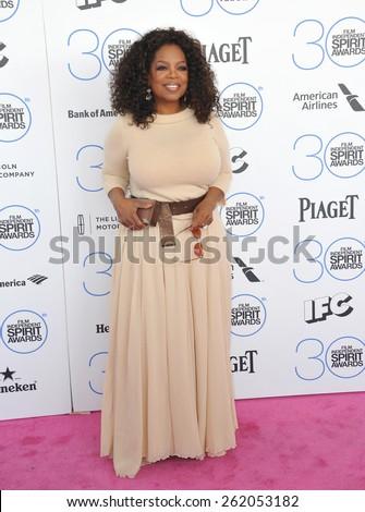 SANTA MONICA, CA - FEBRUARY 21, 2015: Oprah Winfrey at the 30th Annual Film Independent Spirit Awards on the beach in Santa Monica.  - stock photo