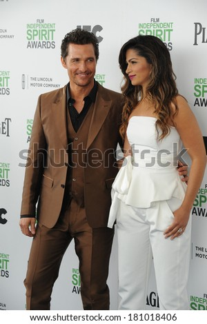 SANTA MONICA, CA - MARCH 1, 2014: Matthew McConaughey & Camilla Alves at the 2014 Film Independent Spirit Awards on the beach in Santa Monica, CA.