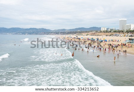 SANTA MONICA, CALIFORNIA - SEP 12: Santa Monica beachgoers on Sep 12, 2015 in Santa Monica, California. The city has 3.5 miles of beach locations and averages 340 days of sunshine every year. - stock photo