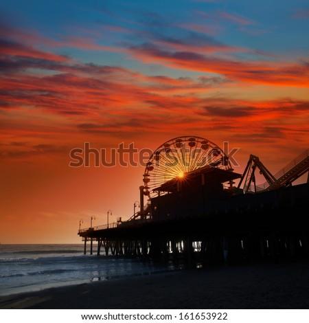 Santa Monica California sunset on Pier Ferris wheel  in orange sky - stock photo