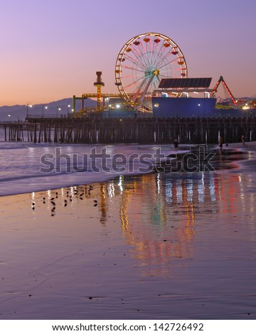 Santa Monica Ferris Wheel and Pier. Old ferris wheel, which has been replaced by a new one. Santa Monica, California, USA. - stock photo