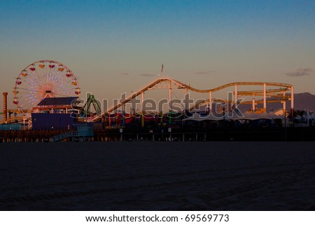 Santa Monica Pier Amusment Park Ferris Wheel and Roller Coaster at Sunrise