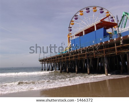 Santa Monica Pier, California with Ferris Wheel and the Pacific Ocean - stock photo