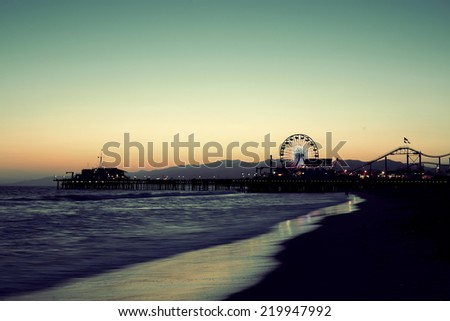 Santa Monica Pier on beach in Los Angeles - stock photo