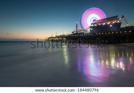 Santa Monica's California Ferris wheel at dusk - stock photo
