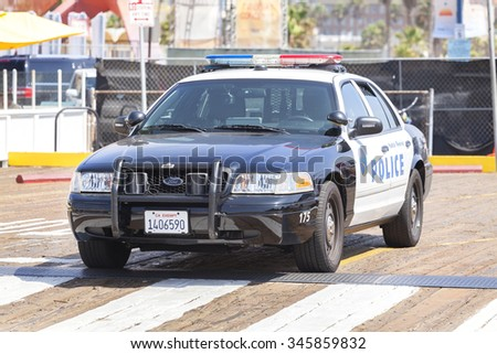 SANTA MONICA, USA - AUGUST 22, 2015: Santa Monica Police car parked in front of a pier. In 2014, crime in Santa Monica was at its lowest level in more than 50 years. - stock photo