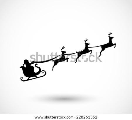 Santa on a sleigh with reindeers - stock photo