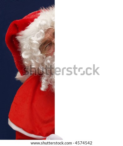 Santa playing peepo behind your message - stock photo