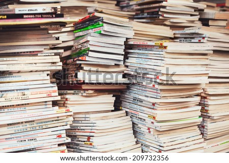 SANTA PORTO MARGHERITA, ITALY - JULY 27: Piles of Italian comics magazines TEX in a flea market on July 27, 2014. It is the most popular and enduring Italian comic book series of all time. - stock photo
