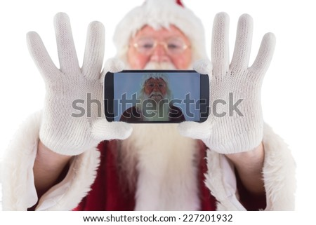Santa records himself with a smartphone on white background - stock photo