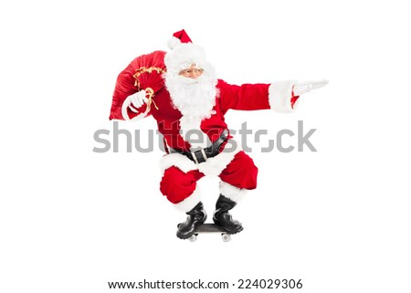 Santa riding a skateboard and holding a bag full of presents isolated on white background - stock photo