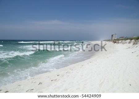 SANTA ROSA ISLAND, FL - MAY 9: Pristine white sand beach and tourism are threatened by the BP oil spill May 9th, 2010, on Santa Rosa Island, FL. - stock photo