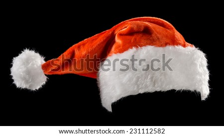 Santa's hat on a black background - stock photo