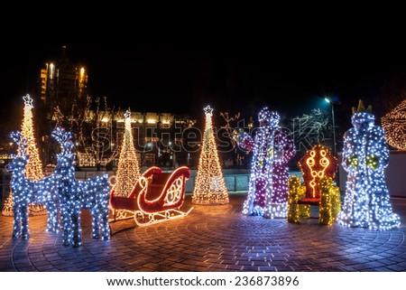 Santa, Snow White and a sleigh decoreted with lights. Pazardzhik city centre Christmas decorations. - stock photo
