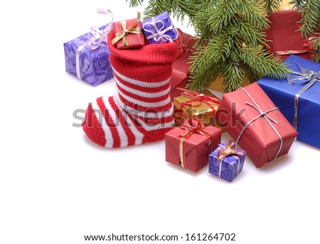 santa stocking  and  gift boxes  under decorated Christmas tree.isolated on white background  - stock photo