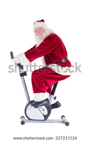 Santa uses a home trainer on white background - stock photo