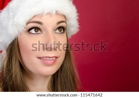 Santa Woman looking up with red background - stock photo