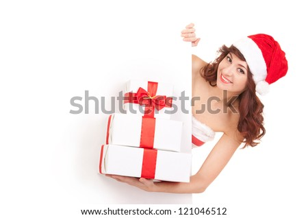 Santa woman with gift boxes looking at white blank board