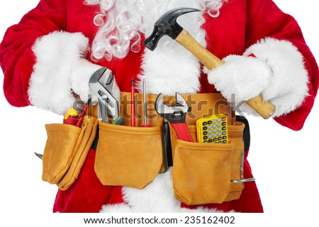 Santa Worker with a tool belt over white background. - stock photo
