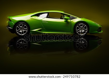 SANTAGATA BOLOGNESE, BOLOGNA, ITALY - JAN 20 - Toy lamborghini huracan on   yellow background, Tuesday 20 January 2015 - stock photo