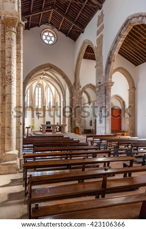 Santarem, Portugal. September 12, 2015: The aisle and Naves of the Santa Clara Church. 13th century Mendicant Gothic Architecture. Santarem is called the Capital of Gothic in Portugal.