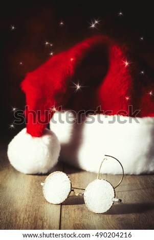 Santas' glasses covered in snow with his hat