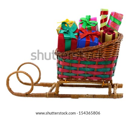 Santas sledge with christmas gifts isolated on white background - stock photo