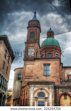 Santi Bartolomeo e Gaetano steeple and dome in Bologna, Italy - stock photo