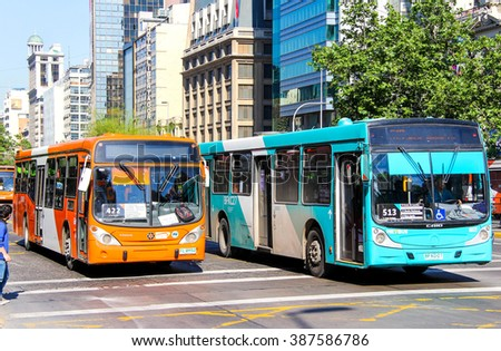 SANTIAGO, CHILE - NOVEMBER 13, 2015: City buses Marcopolo Gran Viale and Caio in the city street. - stock photo
