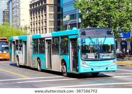 SANTIAGO, CHILE - NOVEMBER 13, 2015: Green articulated city bus Caio in the city street. - stock photo