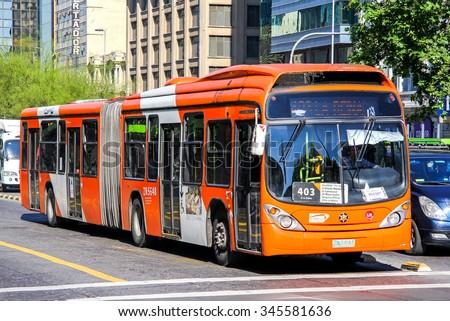 SANTIAGO, CHILE - NOVEMBER 13, 2015: Orange city bus Marcopolo Gran Viale at the city street. - stock photo