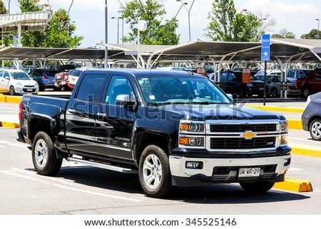 SANTIAGO, CHILE - NOVEMBER 24, 2015: Pickup truck Chevrolet Silverado at the city street. - stock photo