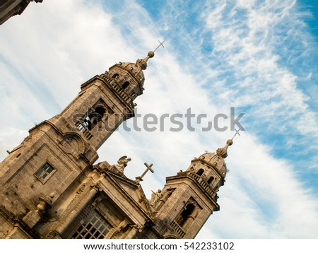 SANTIAGO DE COMPOSTELA, ES - OCTOBER 2016: The goal for all the pilgrims on the Saint Jacobs pilgrimage (camino de Santiago) is the cathedral. This is the little church in front of it.