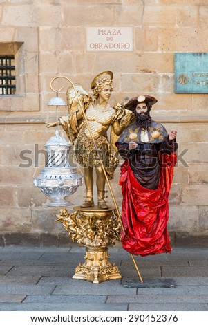 "SANTIAGO DE COMPOSTELA - SPAIN: June 18. 2014 - street artists performing as living statue ""Saint James and Angel"""