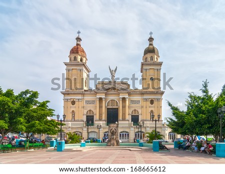 SANTIAGO DE CUBA, CUBA - APRIL 31: View to Catedral Nuestra Senora de la Asuncion over Cespedes park with lot of tourists and locals shown on 31 April 2008 in Santiago de Cuba, Cuba.  - stock photo