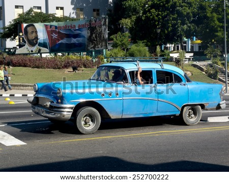 SANTIAGO DE CUBA, CUBA - NOVEMBER 29:  An american vintage blue car in the center of the town ,on november 29, 2014, in Santiago de Cuba, Cuba  - stock photo