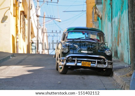 SANTIAGO-DECEMBER 27:Oldtimer in the streets of Santiago de Cuba on December 27, 2012.Under the law that changed in 2012,Cubans could only buy and sell cars that were in use before 1959 - stock photo
