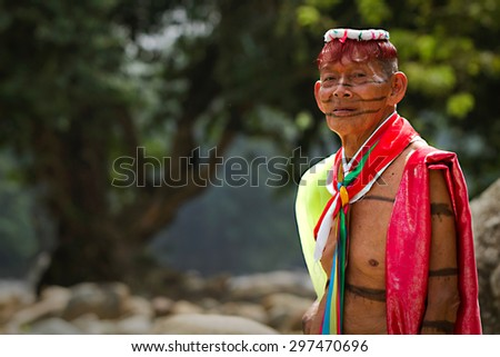 SANTO DOMINGO, ECUADOR - AUGUST 5, 2011: Unidentified indigenous shaman from the indigenous group of Santo Domingo de los Tsachilas - stock photo