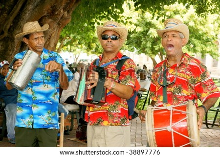 SANTO DOMINGO - OCTOBER 9: Musicians in action during Dominican Republic's weekend street celebrations October 9, 2009 in Santo Domingo, Dominican Republic. - stock photo