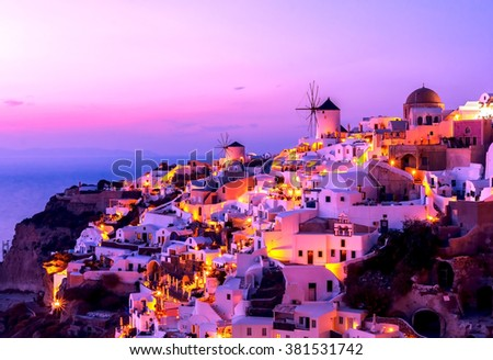 Santorini at night after sunset and purple sky, Mediterranean sea - stock photo