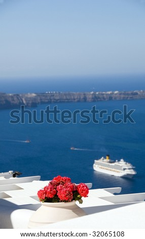 santorini caldera view of aegean sea and volcanic islands with cruise ship in harbor from imerovigli - stock photo