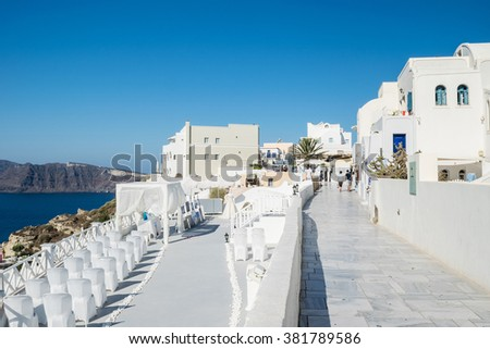 Santorini, Greece â?? August 2015 : Typical and amazing street in Oia city, Santorini, Greece - stock photo