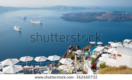SANTORINI, GREECE - OCTOBER 7, 2015: The outlook over the luxury resort in Imerovigili to caldera with the cruises and Na Kameni island.