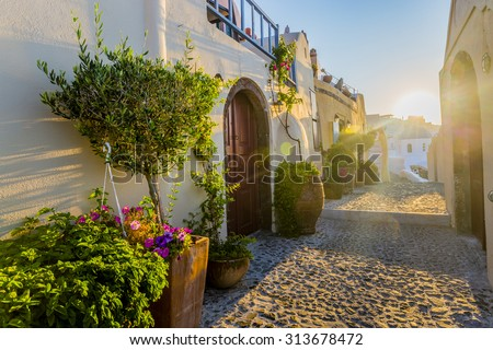 Santorini, Greece - Oia street at sunrise - stock photo