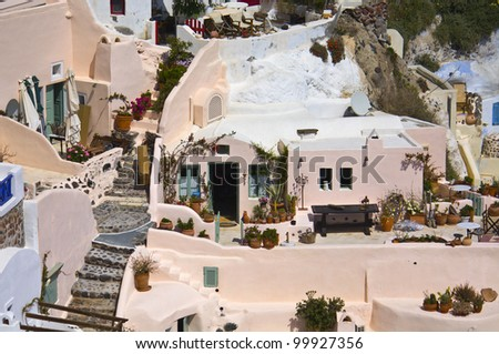 Santorini island and the village of Oia at the cyclades, aegean sea, Greece - stock photo