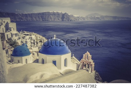 Santorini Island scene with  blue dome churches faces Caldera, Greece