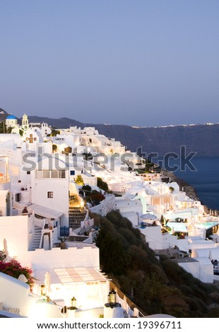 santorini magic at sunset cyclades architecture over the sea oia ia view of imerovigli in distance  greek islands greece - stock photo